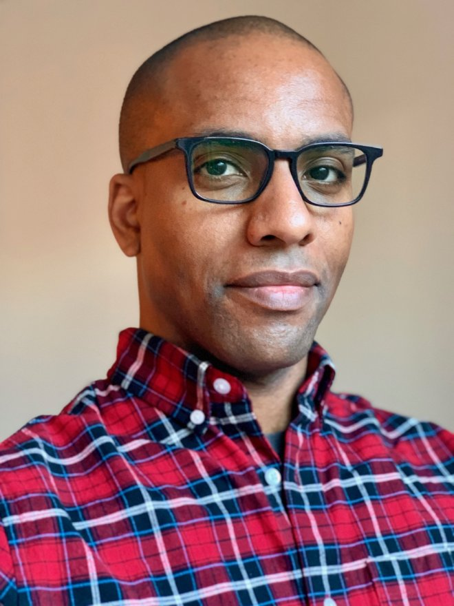 Sean Oliver in glasses and plaid shirt
