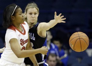 St. John's guard Keylantra Langley, left, passes against Seton Hall guard Tara Inman during the first half of an NCAA college basketball game in the quarterfinals of the 2014 Big East women's tournament in Rosemont, Ill., Sunday, March 9, 2014. (AP Photo/Nam Y. Huh)