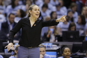 Tufts head coach Carla Berube directs her team as they play Thomas More during the first half of the championship game at the women's NCAA Division III basketball tournament in Indianapolis, Monday, April 4, 2016. (AP Photo/Michael Conroy)