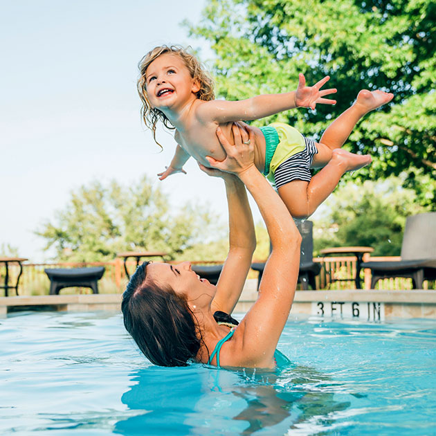 Mom and child playing in pool