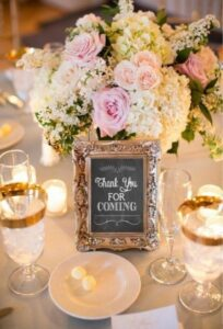 """Gold picture frame with chalk sign inside that reads """"thank you for coming""""."""