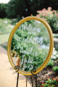 Gold frame used as DIY wedding decor to welcome guest