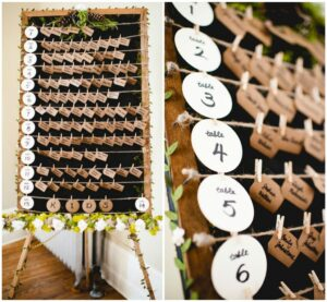 Escort card display sign using frame and string for a rustic feel.