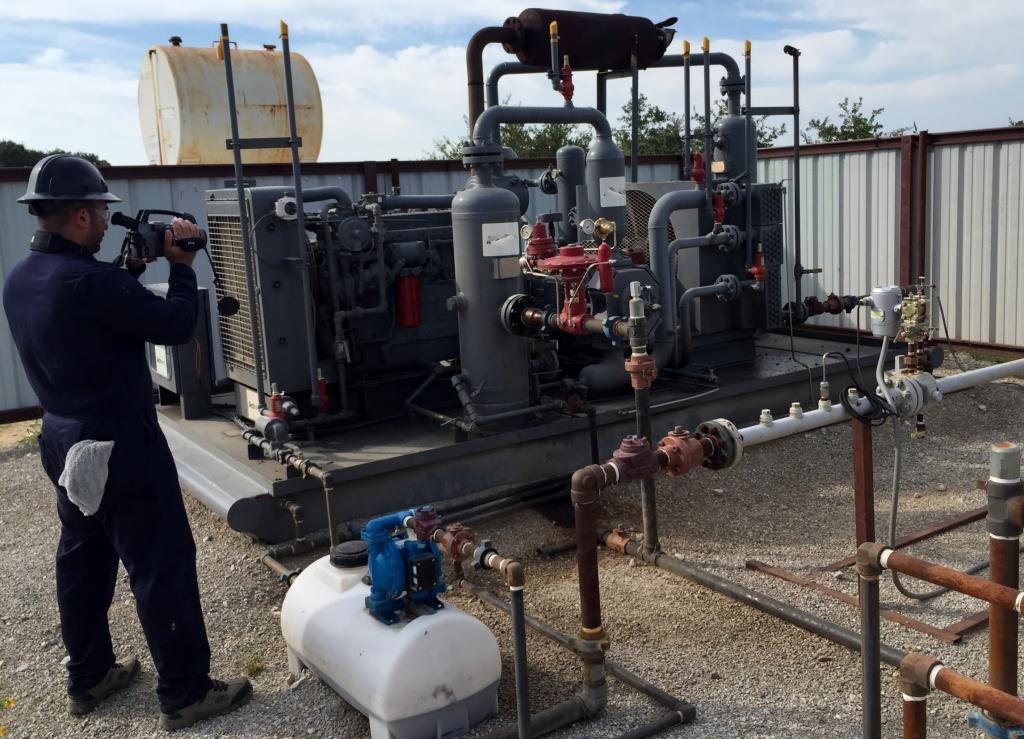 OTA OGI certified technician surveying a compressor