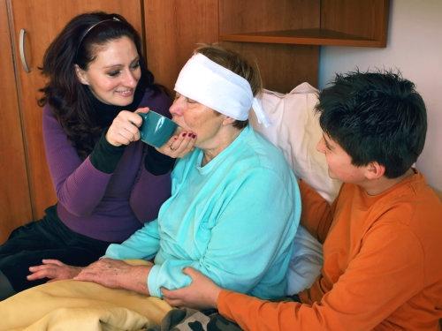 caregivers taking care of an elder