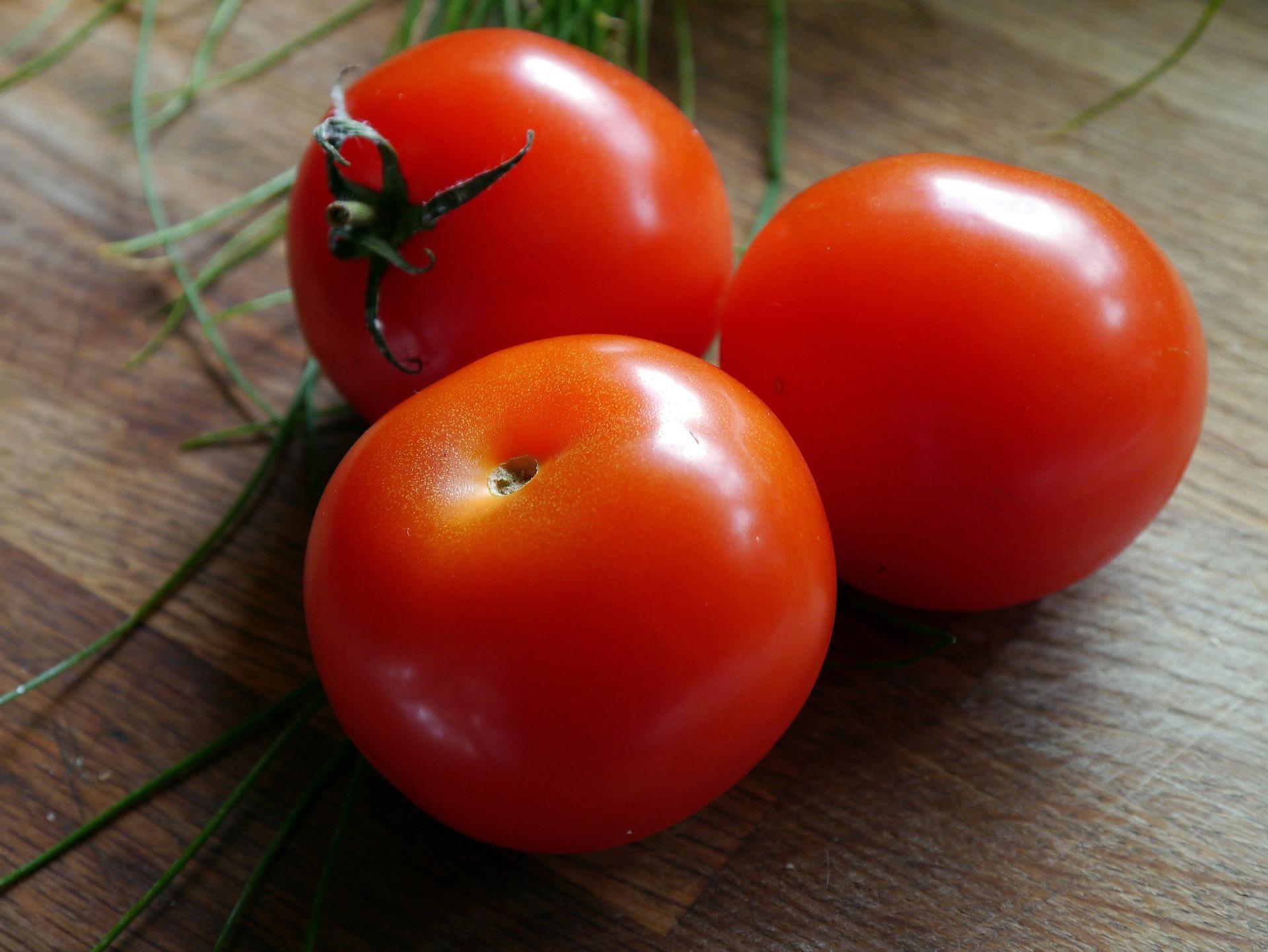 three red tomatoes