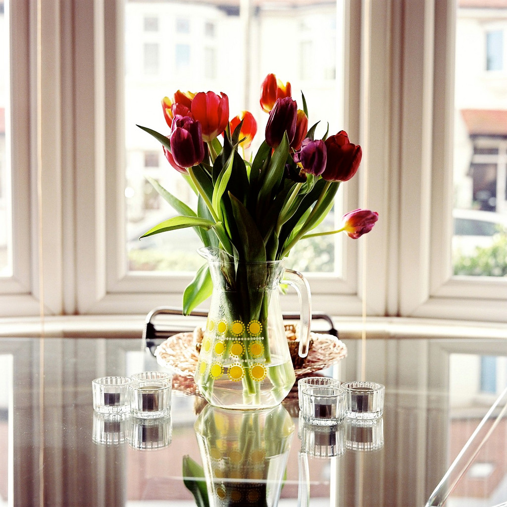 flower display on shiny table