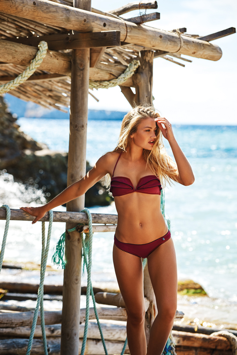 A two-piece with pleated bandeau bra top and deep-V is featured in a rich wine shade by Beachlife.
