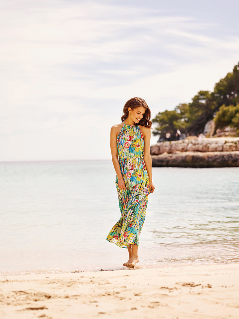 Blooming with color, a floral-print maxi dress from RÖSCH is made of easy-care viscose with the illusion of plissé. Elastic waist and tie-closure at back of neck adds additional style and comfort.