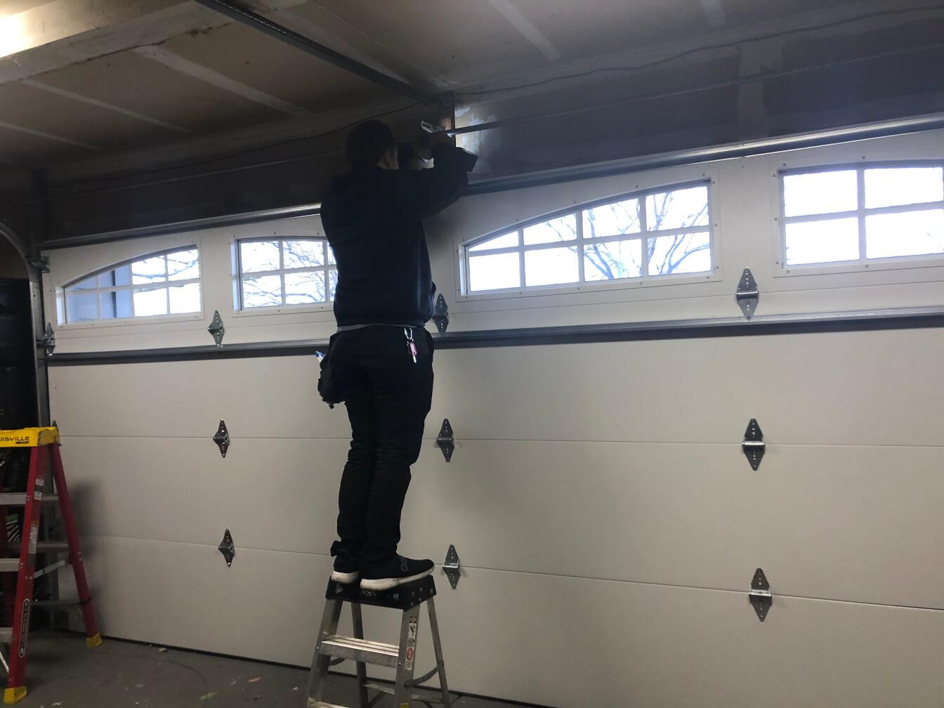 picture of garage door service tech at work.