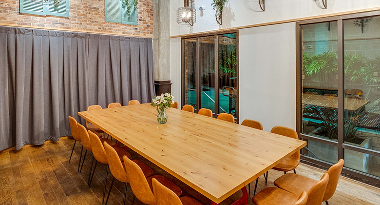 Private dining room at Cardellino with wood floors, brick wall and windows