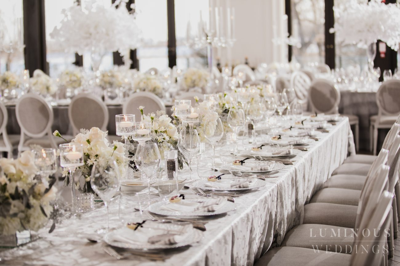 Elegant glass and white roses wedding decor