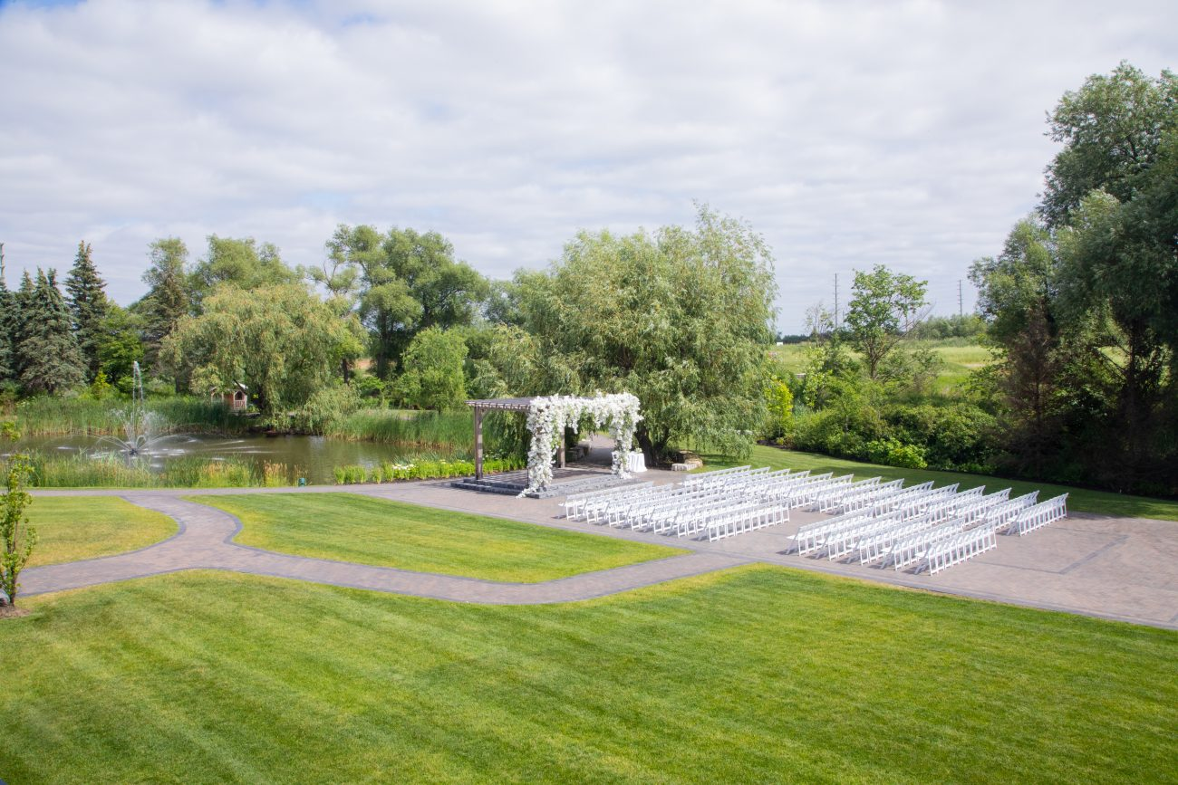 Outdoor wedding ceremony by the pond