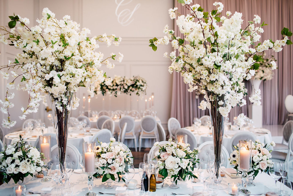 Elegant white and grey and blush wedding venue decor