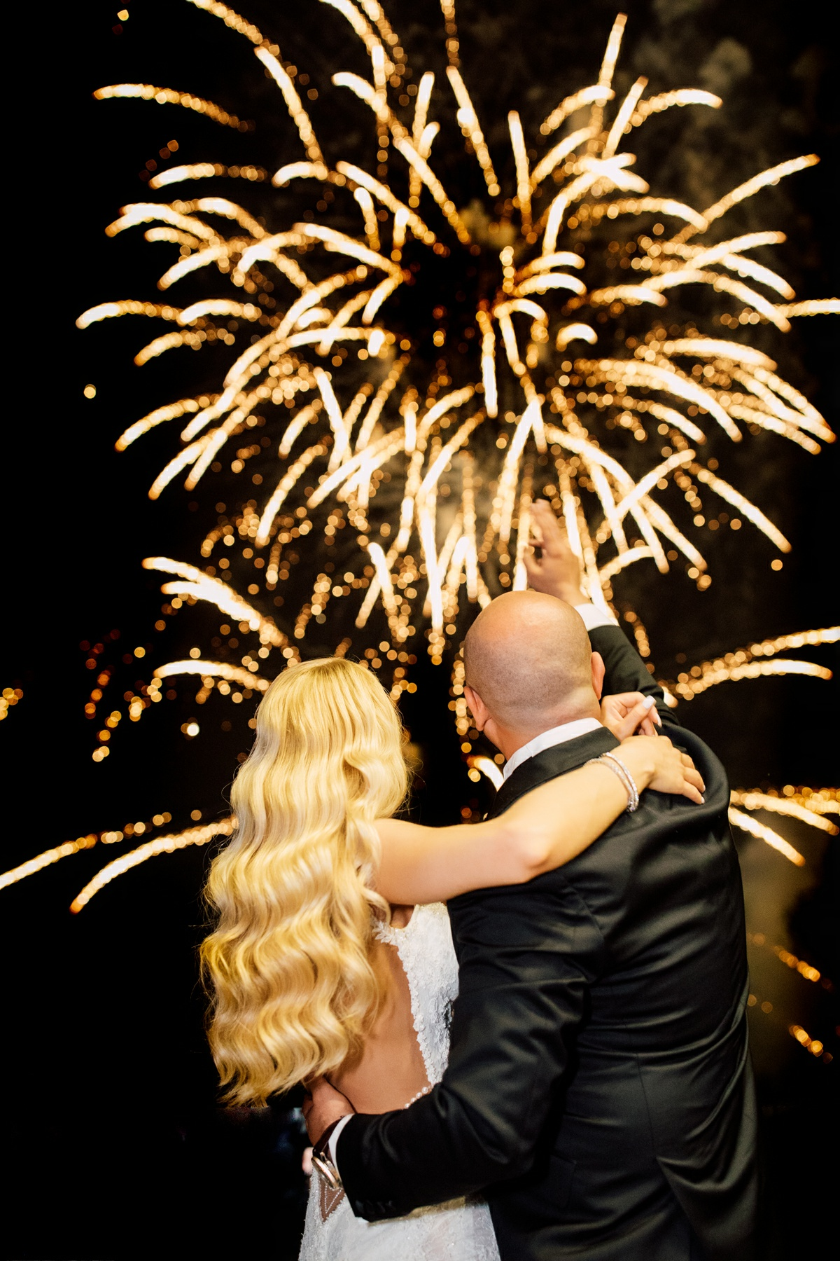 Newlyweds watching fireworks