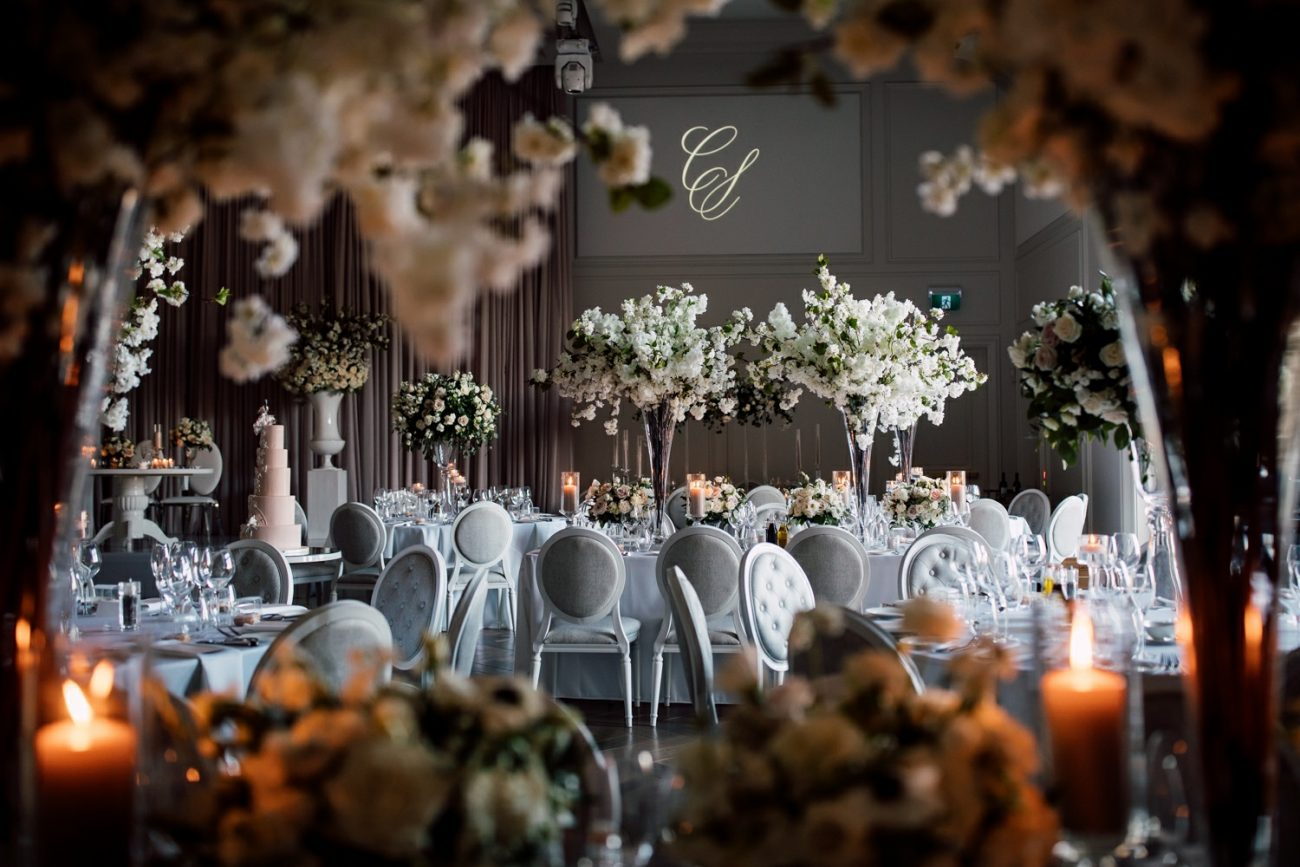 Elegant white and grey wedding venue decor