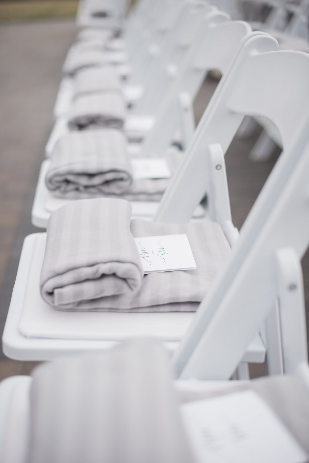 shawls provided on chairs for outdoor wedding event