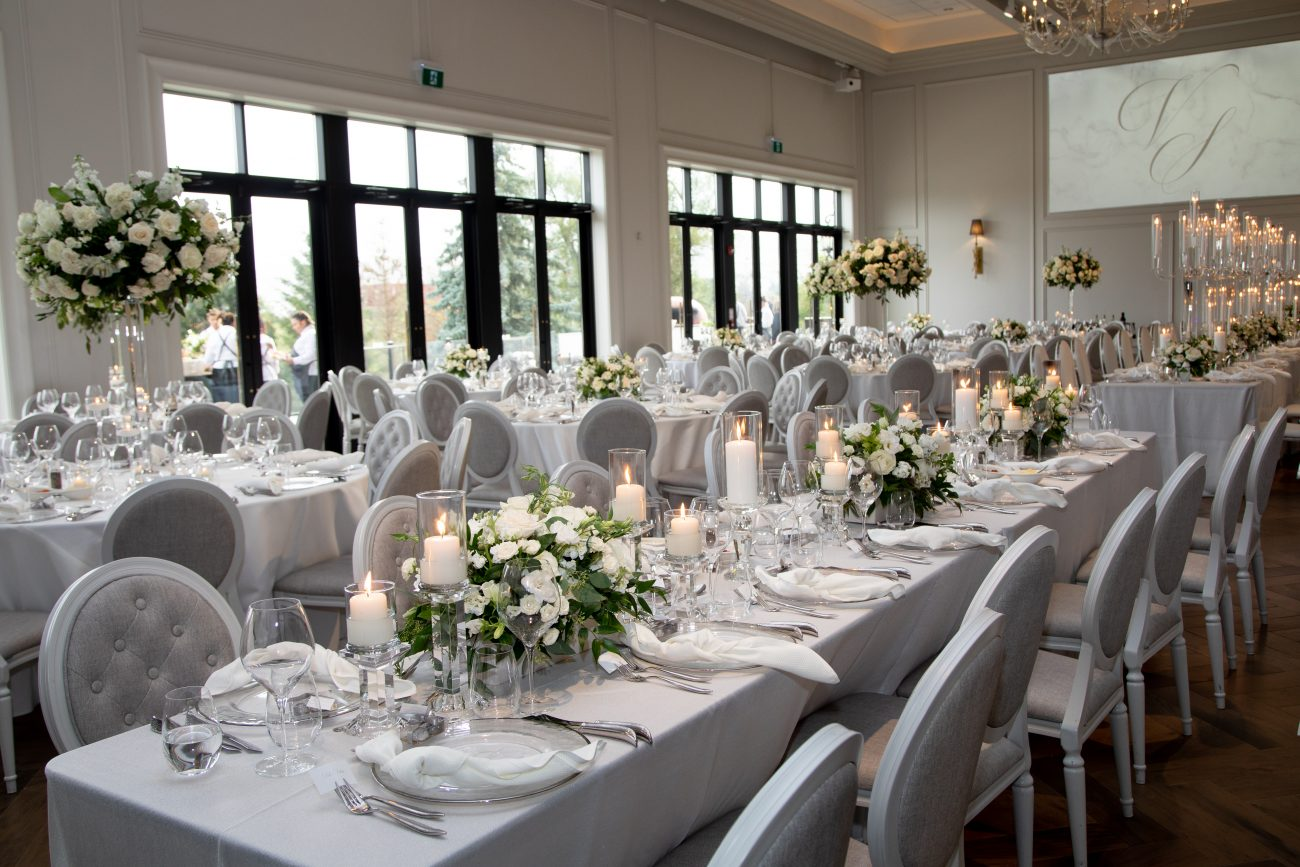 elegant white roses and grey chairs wedding decor