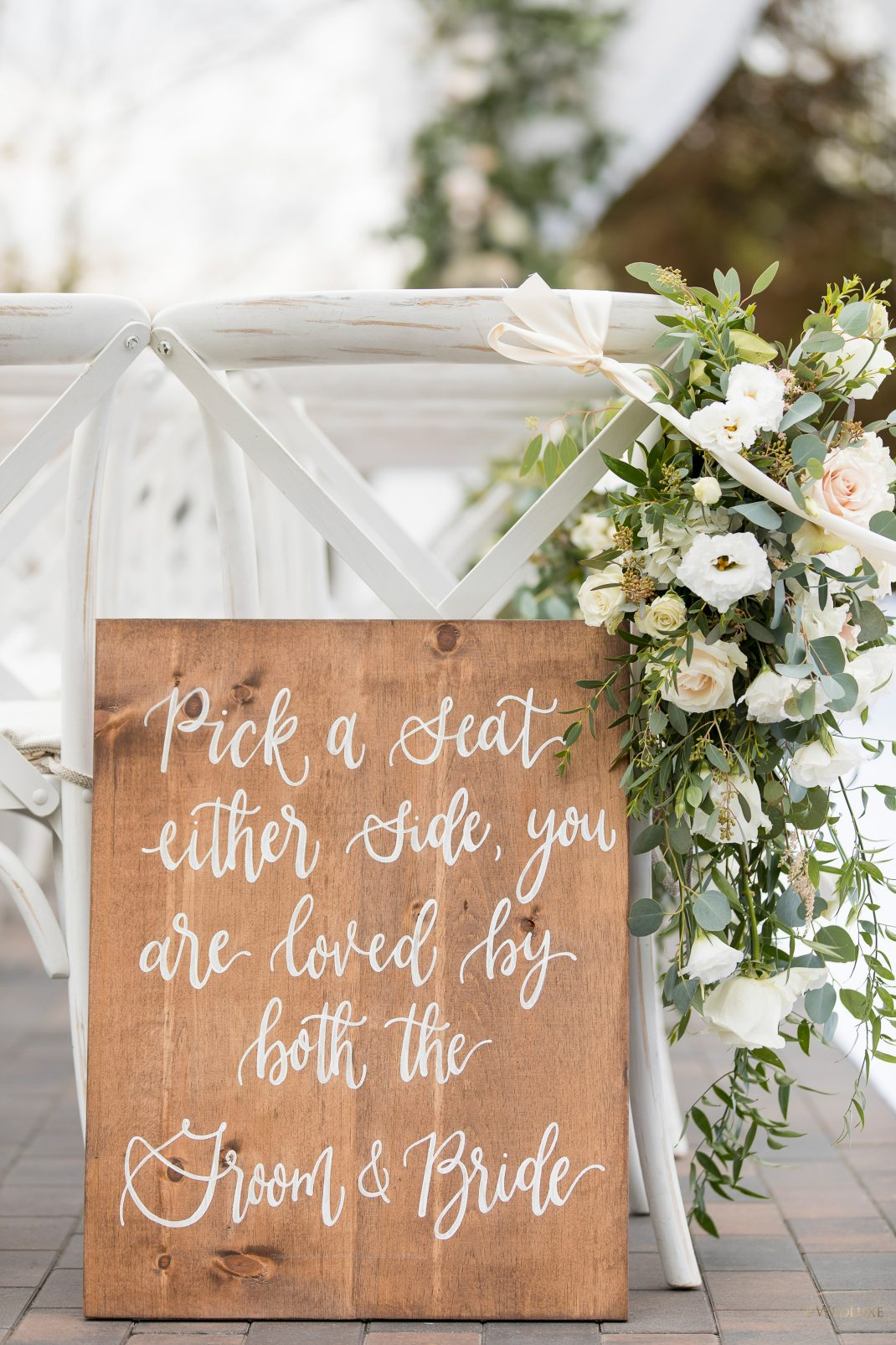 Rustic wood pick a seat sign for outdoor ceremony