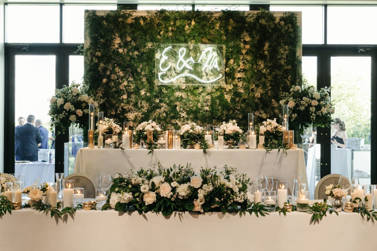 The West Wing Blush roses and greenery wall feature