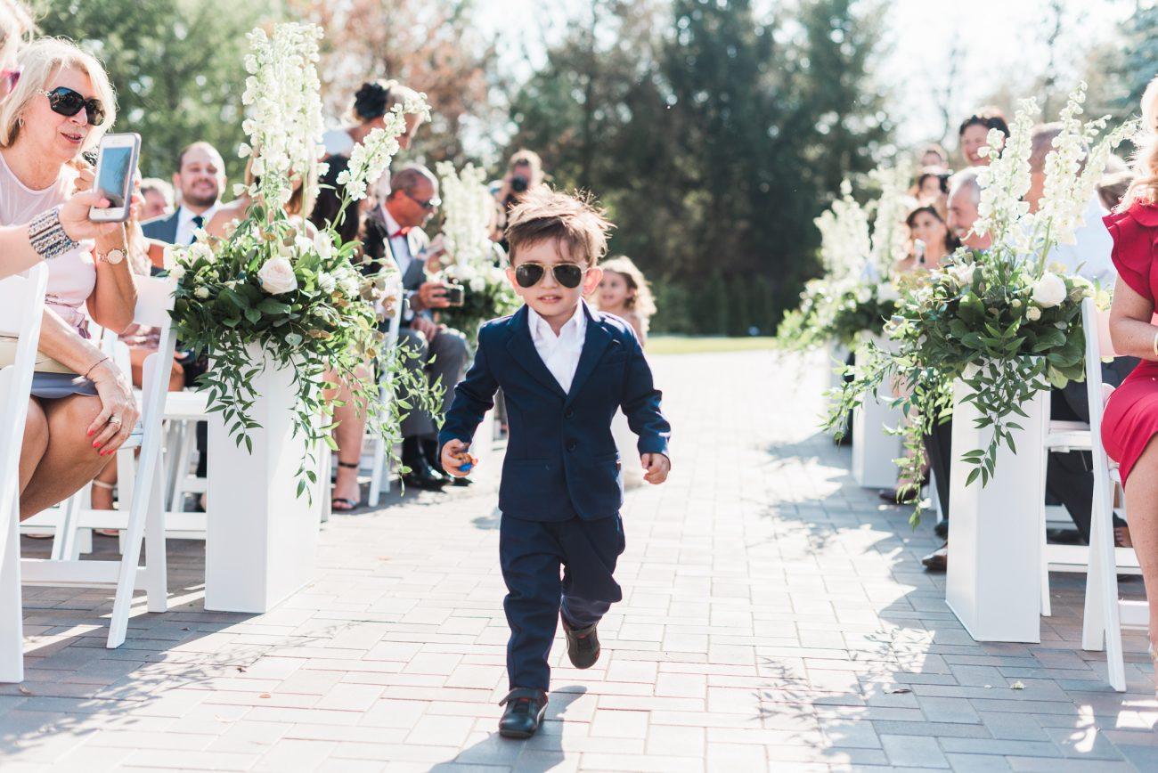 outdoor ceremony with ring bearer