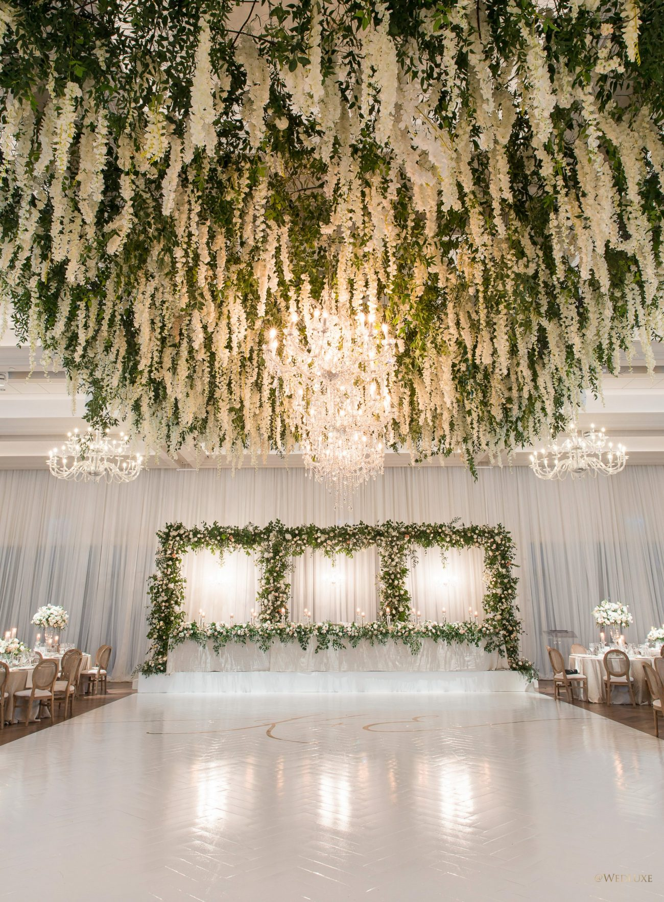 Elaborate wisteria and flowers hanging ceiling feature for wedding