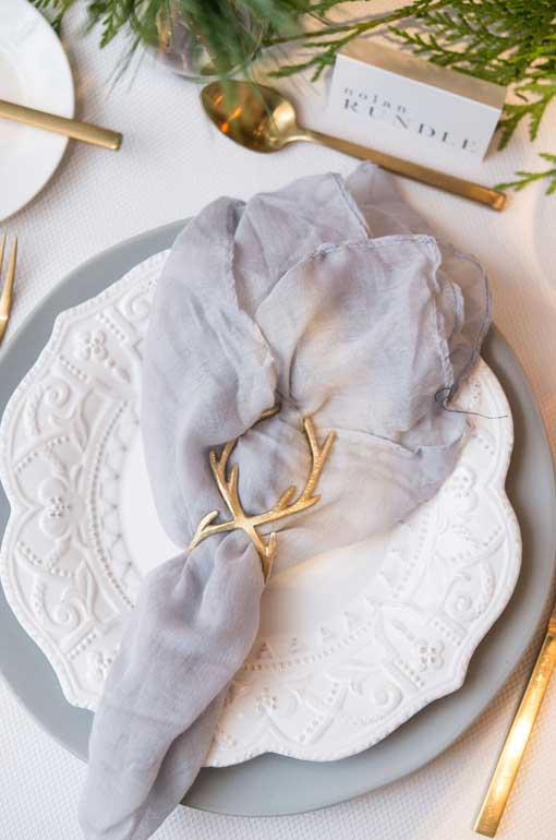 holiday table setting with antler napkin ring