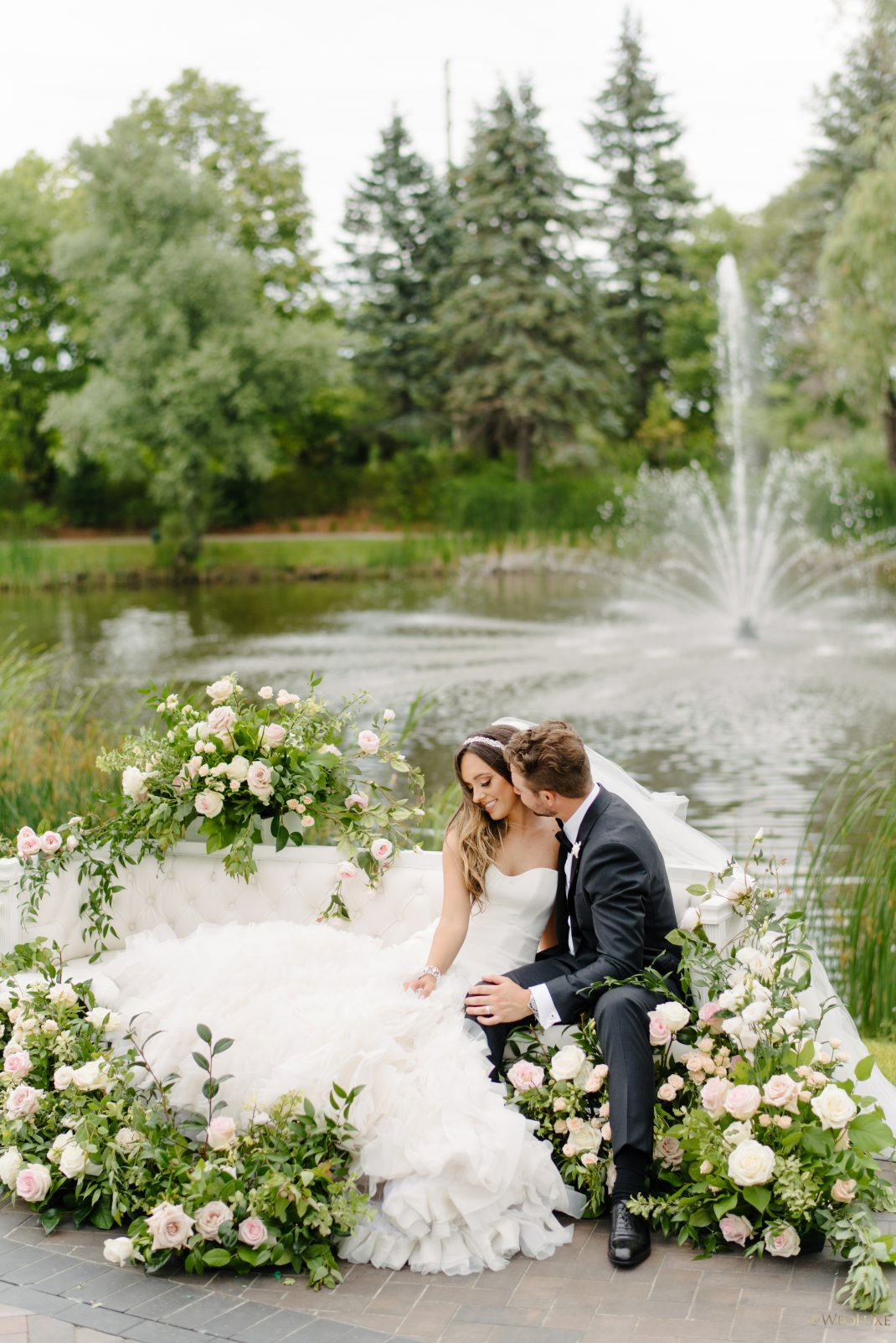 Newlywed posing by the pond