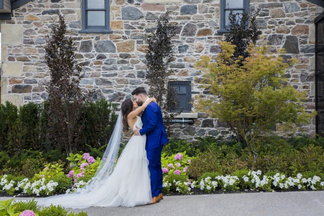 Beautiful couple kissing in front of the Heritage House