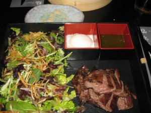 Steak-in-the-box, Thai style angus skirt steak with a soft boiled egg and mixed salad with crispy shredded potato, $19