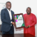 Mustapha Ussif (left) Executive Director of the Ghana National Service Scheme (NSS) receiving a certificate from Chief Akilu Sayibu Managing Director of The Voiceless Consult