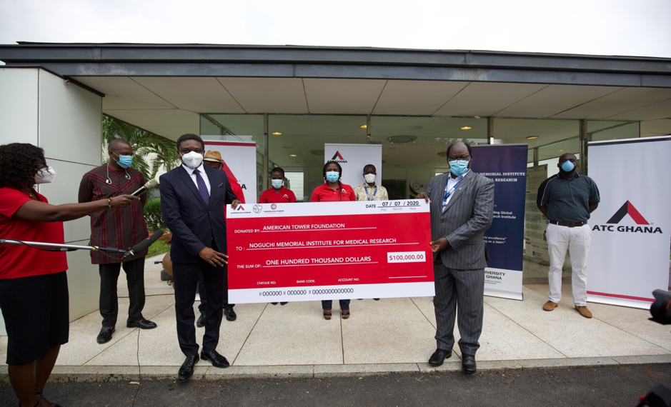 ATC Ghana Chief Executive Officer, Yahaya Yunusa (left) presenting the dummy cheque to Prof. Abraham Annan (right), Director of Noguchi Memorial Institute for Medical Research.