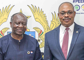 Ken Ofori-Atta, Finance Minister with Professor Vincent O. Nmehielle, Secretary General of the AfDB