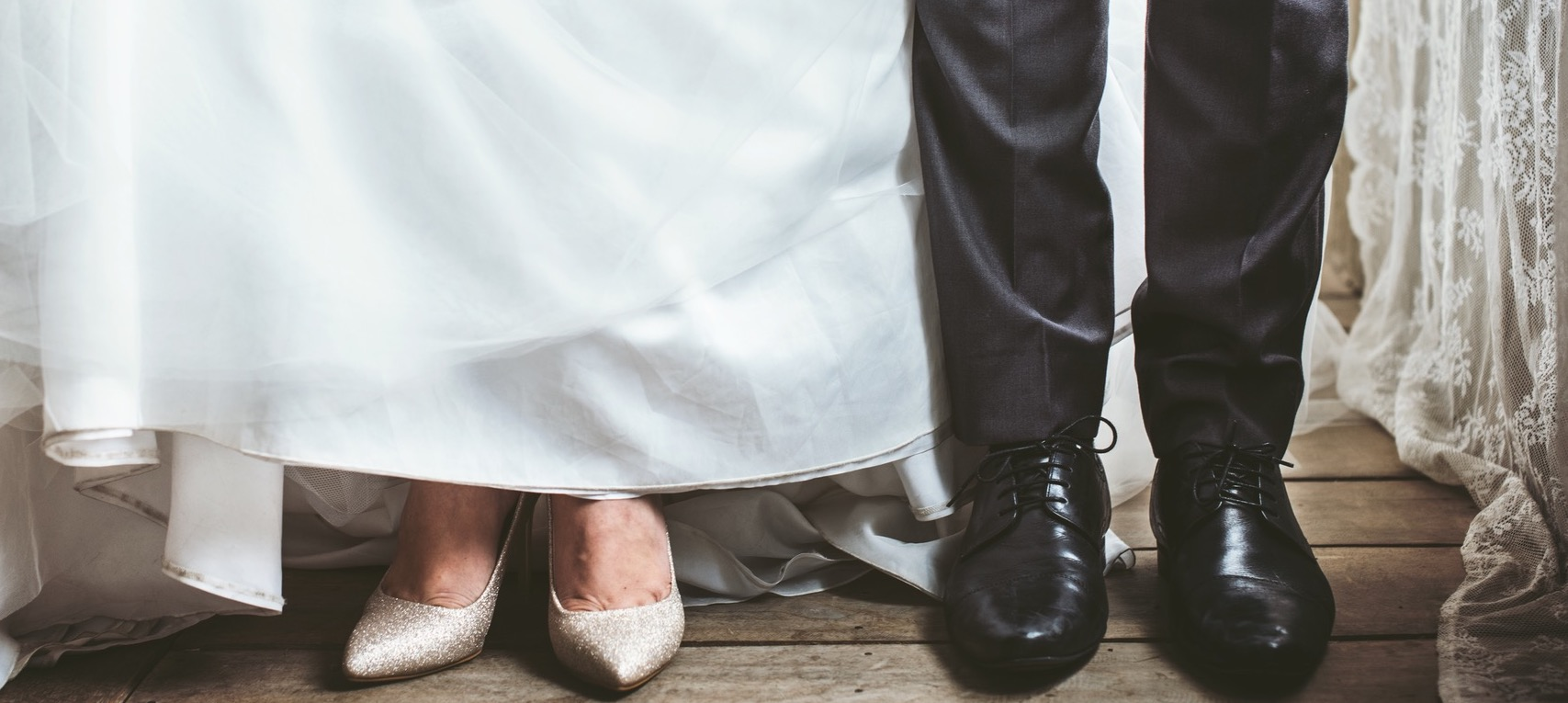 The feet of a bride and a groom