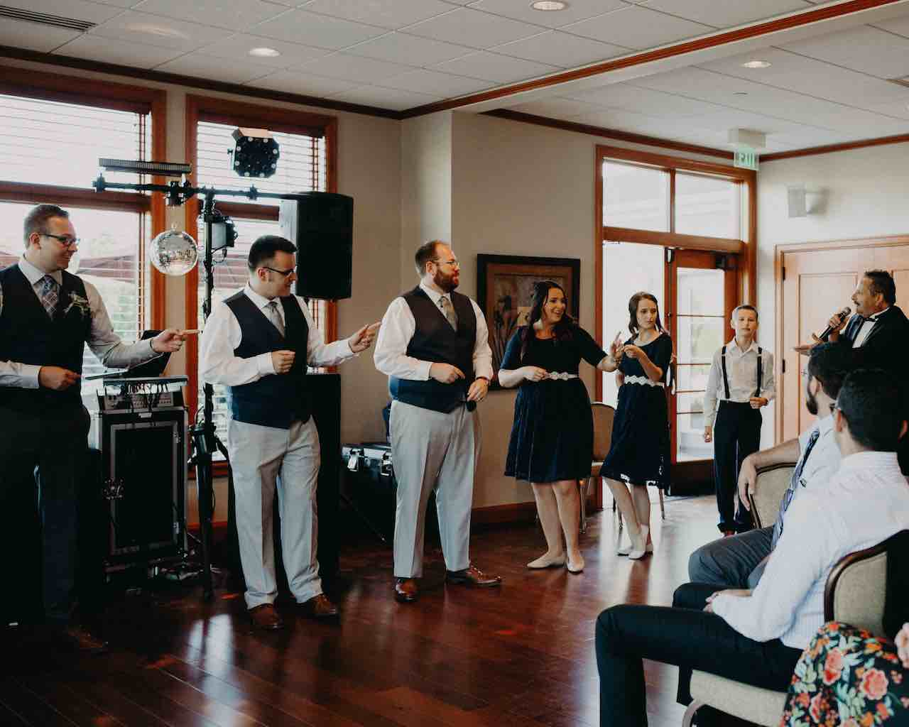 Wedding party getting things going under the direction of Paul