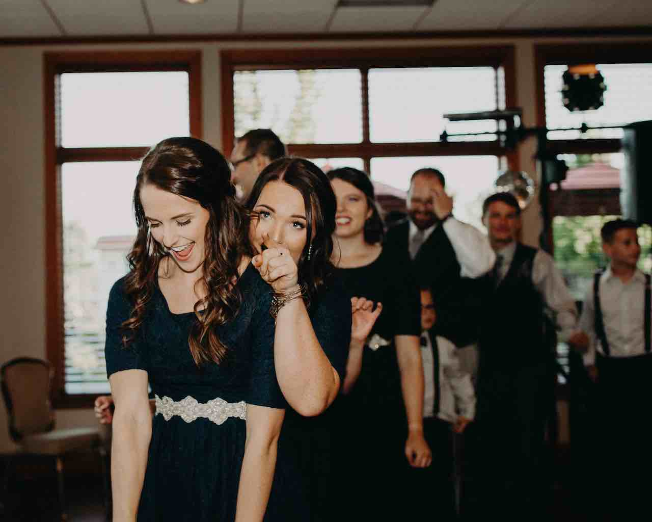 A conga line gets everyone at the wedding out of their chairs
