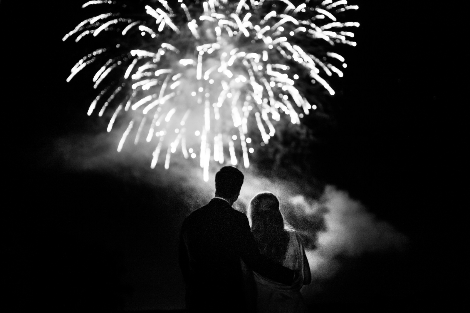 Fireworks with bride and groom at wedding