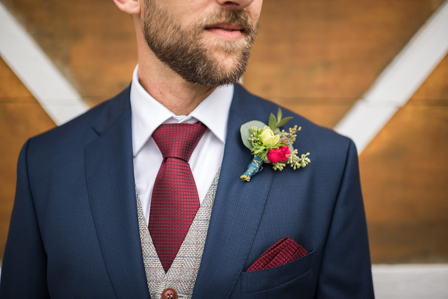 Groom and boutonniere at Whidbey Island wedding at Comforts Winery