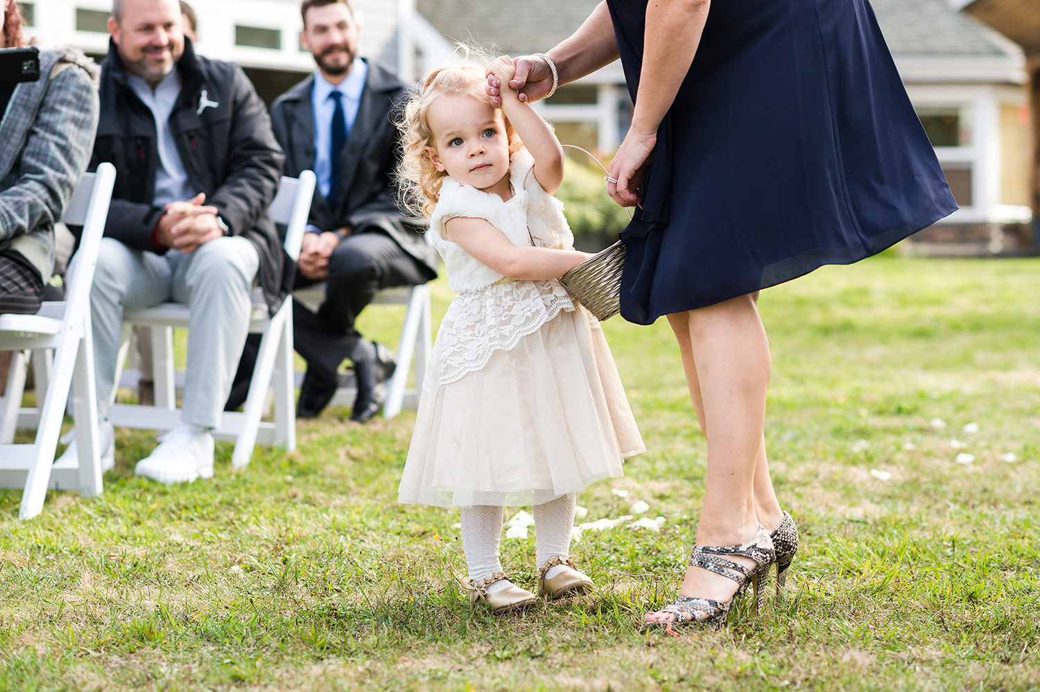 Flower girl during a Whidbey Island wedding at Comforts Winery