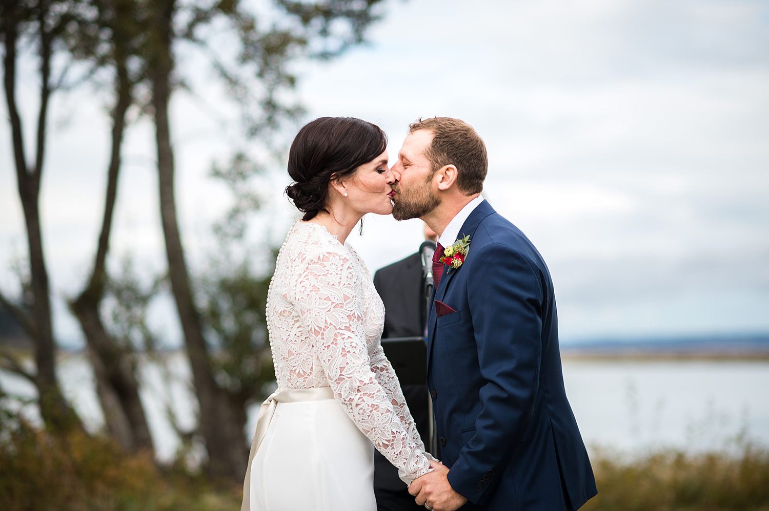 Bride and Groom kiss outside at the end of a Whidbey Island wedding ceremony