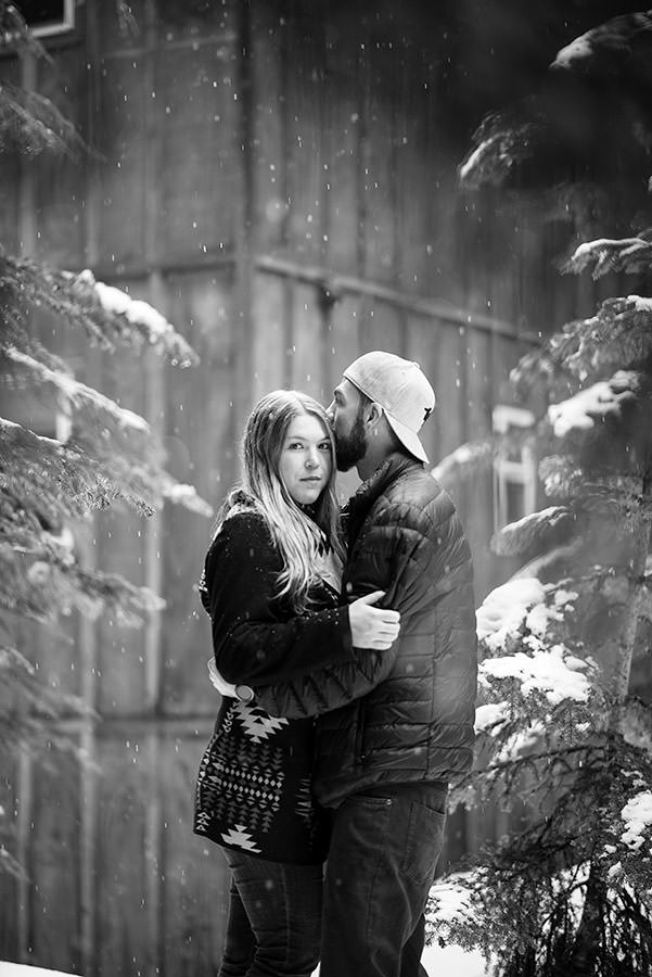 Black and White Snowshoe engagement session at Snoqualmie Pass outside Seattle under snowy trees