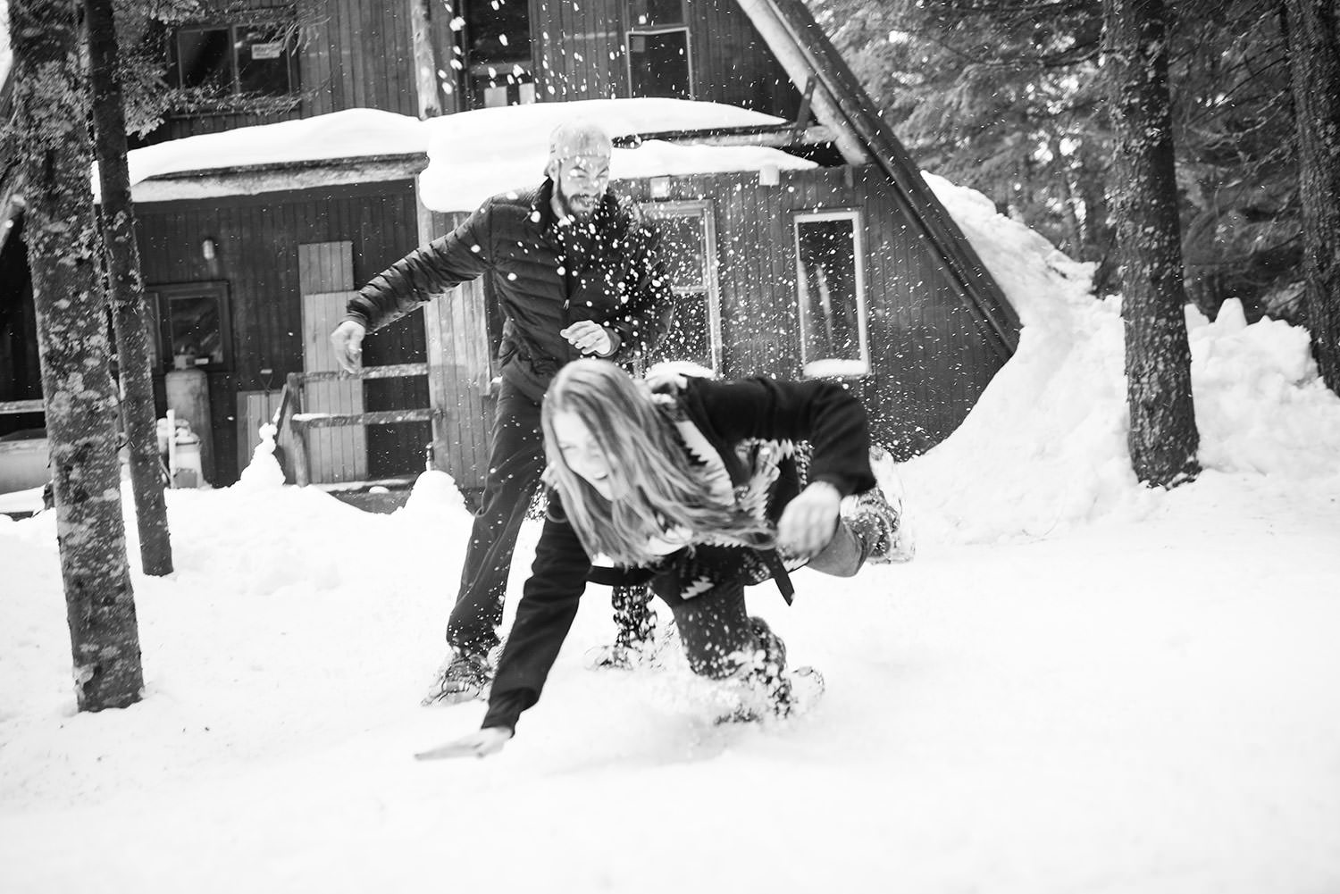 Falling in the snow at an Snowshoe engagement session at Snoqualmie Pass outside Seattle