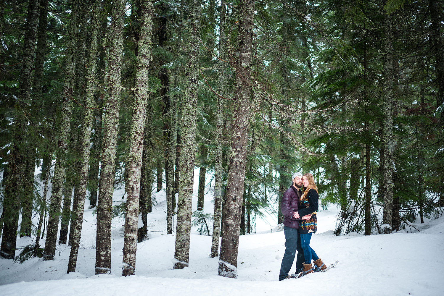 Snowy trees with couple at Snowshoe engagement session at Snoqualmie Pass outside Seattle