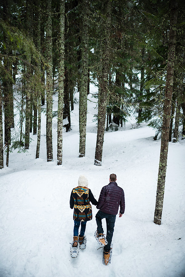 Snowshoe engagement session at Snoqualmie Pass outside Seattle in the snowy trees