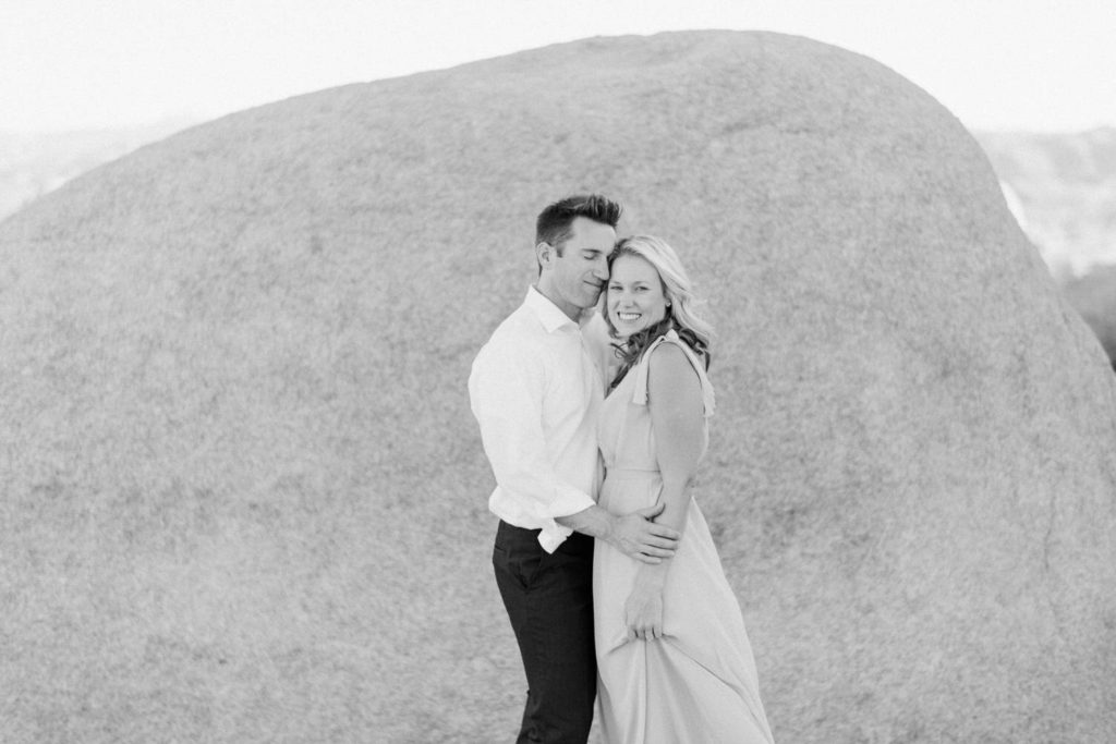 Joshua Tree Couple in Desert with rocks in black and white
