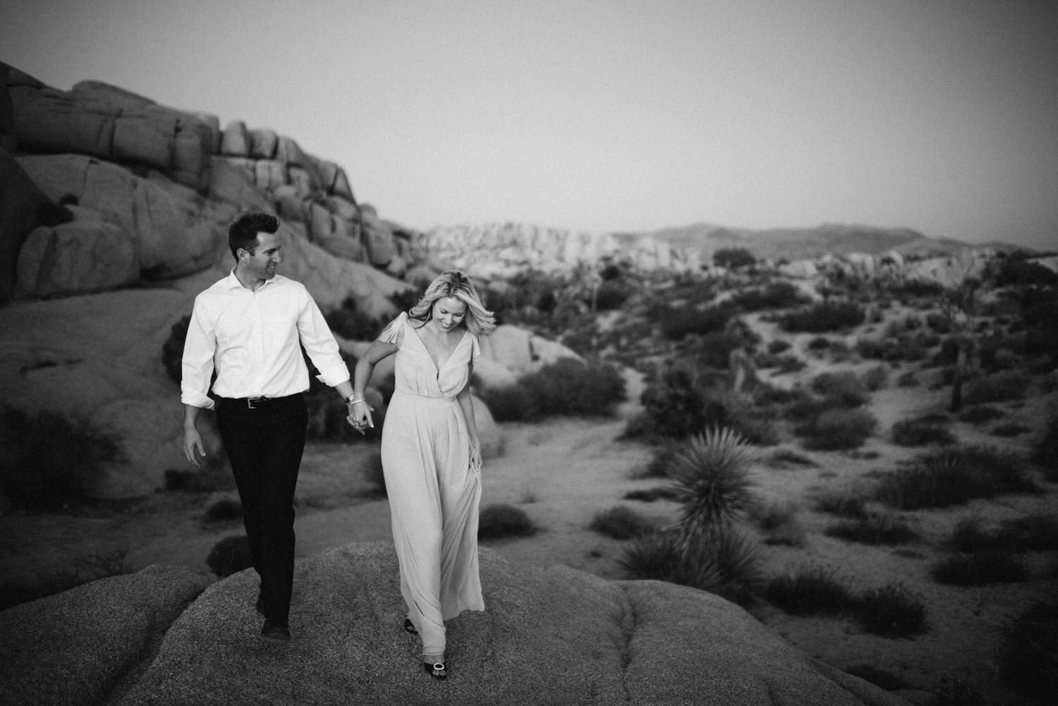 Couple walking through desert during photography session