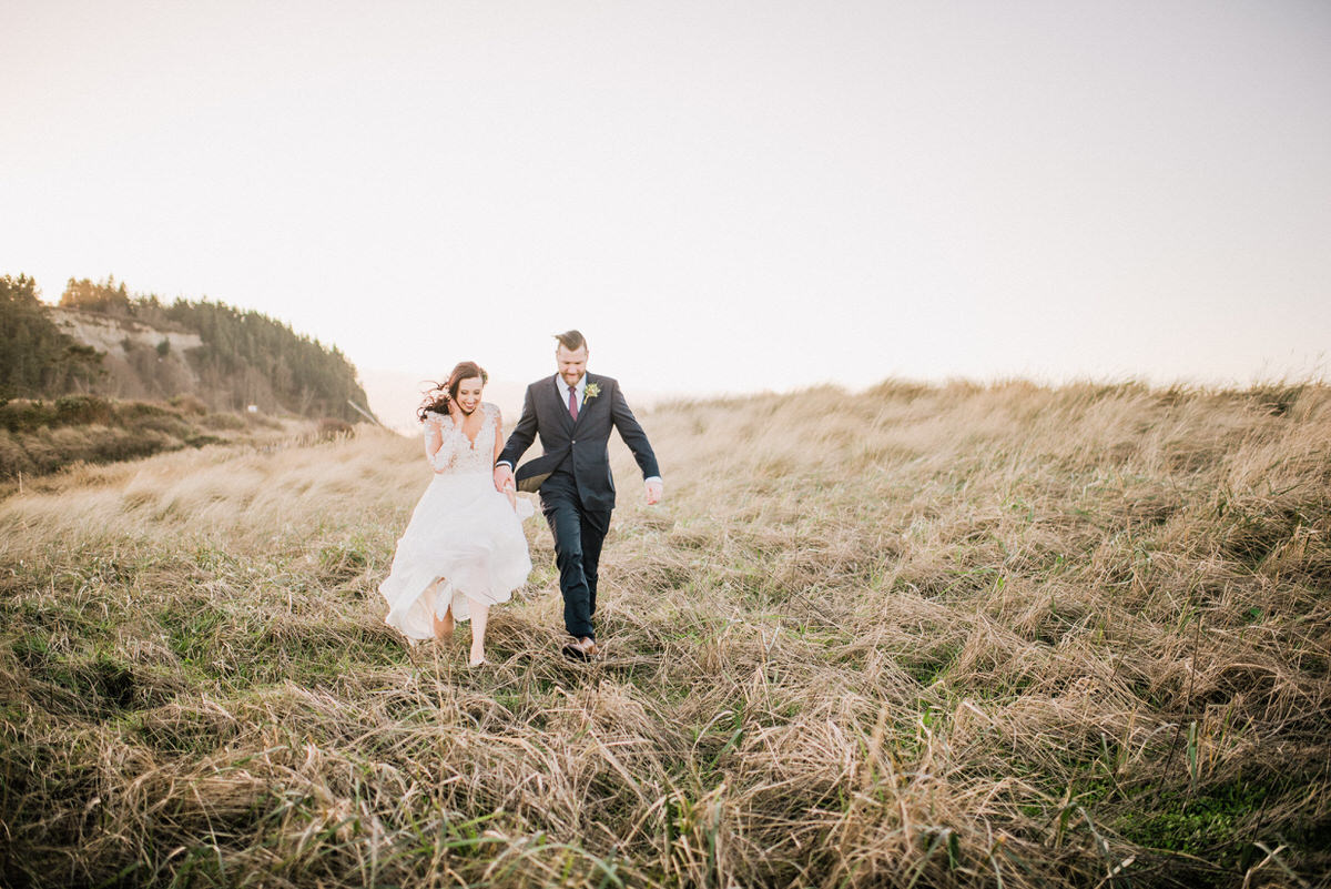 Bride and Groom in grass at Fort Worden Beach Park