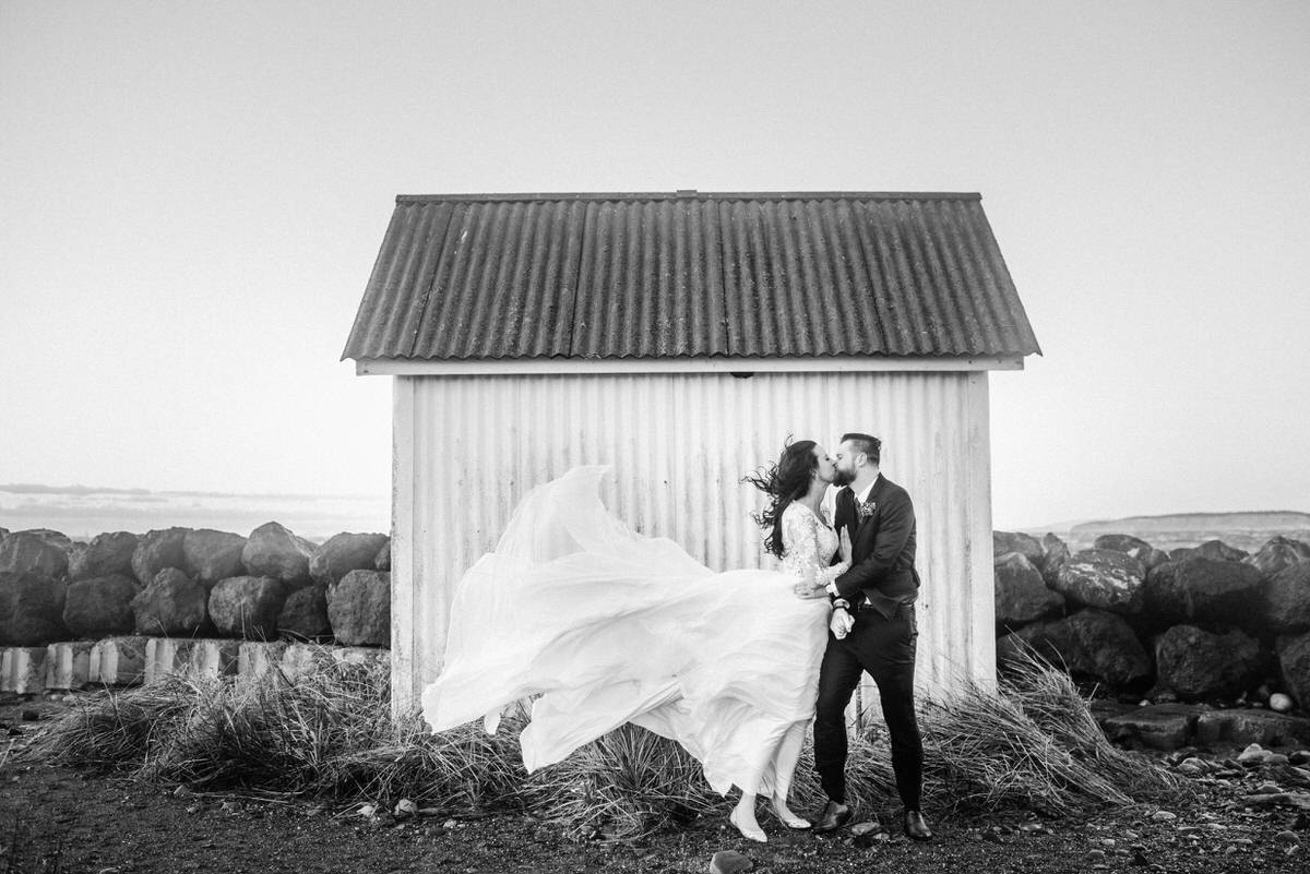 Bride and Groom kissing in the wind at Fort Worden, Washington