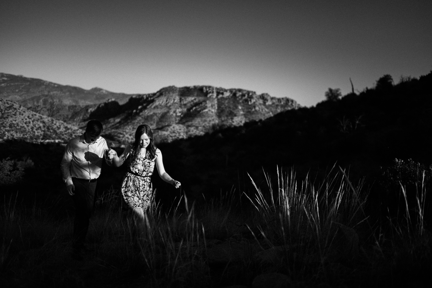 Mount Lemmon engagement session couple walking up hill