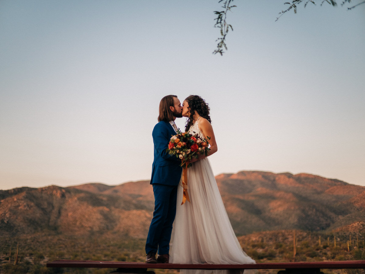 Wedding at sunset with the Tucson mountains behind them